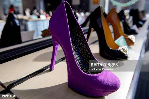 Violet colored high heels shoes at sheo store in San Francisco city, USA