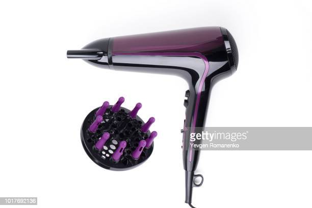 violet hairdryer isolated on a white background - secador de cabelo - fotografias e filmes do acervo