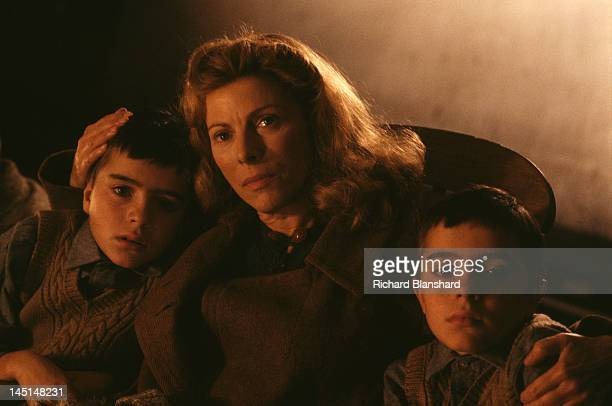 Violet Kray with her twin sons Ronnie and Reggie in a scene from 'The Krays' directed by Peter Medak 1990