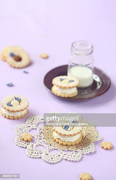 Violet Sandwich Cookies with Cream Cheese Filling