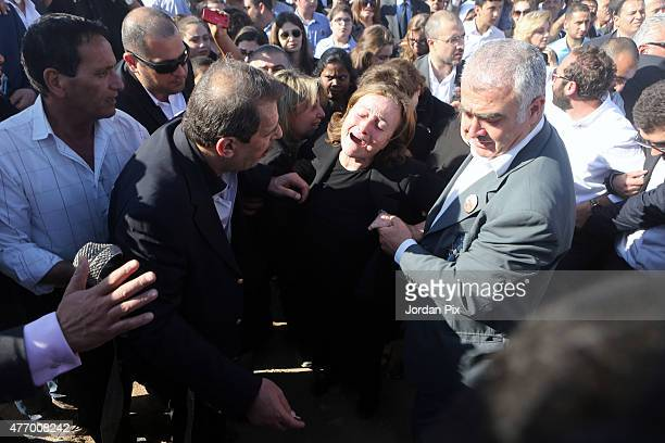 Violet the wife of Tariq Aziz former Iraqi deputy prime minister and top aide of Saddam Hussein mourns carried by their son Ziad as he is laid to...