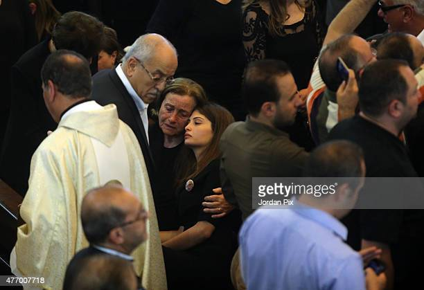 Violet the wife of Tariq Aziz holds her granddaughter with other family members at the funeral for Tariq Aziz the former Iraqi deputy prime minister...