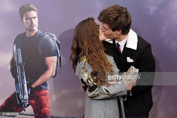 Violetta Komyshan and Ansel Elgort kiss and embrace at the 'Allegiant' premiere at AMC Loews Lincoln Square 13 theater on March 14 2016 in New York...