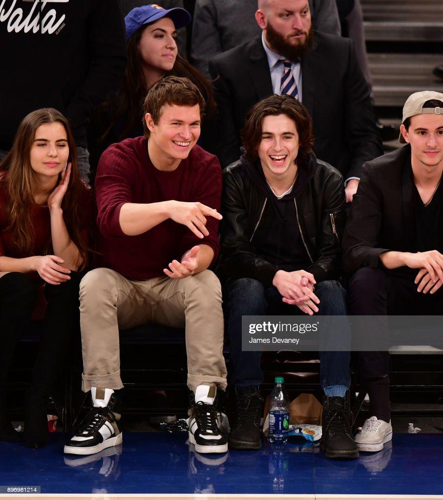Violetta Komyshan, Ansel Elgort and Timothee Chalamet attend the New York Knicks Vs Boston Celtics game at Madison Square Garden on December 21, 2017 in New York City.