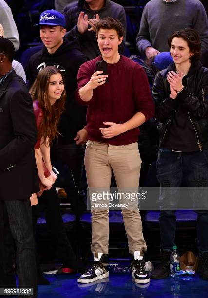 Violetta Komyshan Ansel Elgort and Timothee Chalamet attend the New York Knicks Vs Boston Celtics game at Madison Square Garden on December 21 2017...