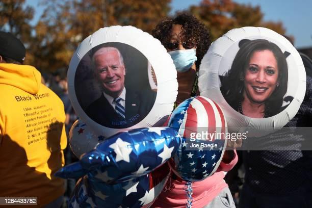 Violetta Smith celebrates the news that Democratic presidential nominee Joe Biden has seemingly won the election while waiting at the Chase Center...