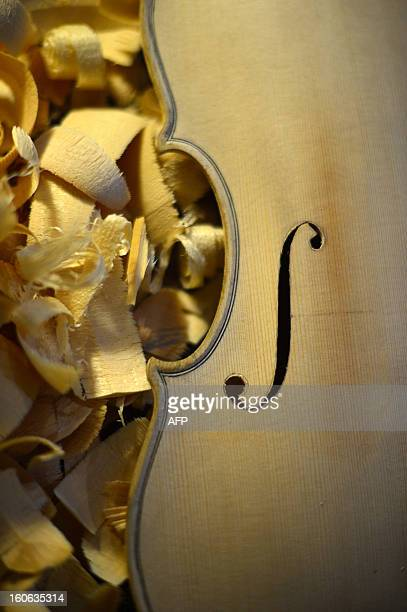 A violin being built is displayed in the workshop of Mathias Menanteau a French violin maker on February 1 2013 in Rome After studying and working in...