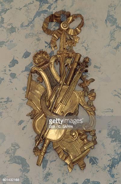 Violin decorative element in gilded wood Music room Chateau de Ravel Auvergne France