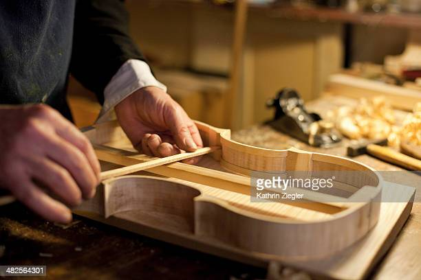 violin maker at work, close-up of hands