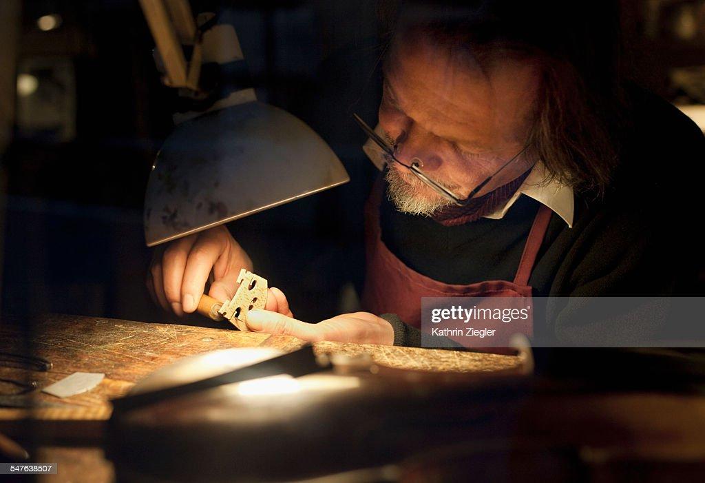 violin maker at work in his studio : Stock Photo