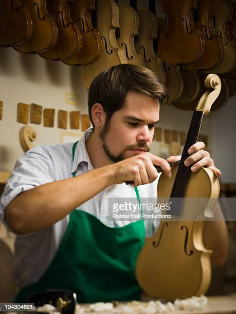 violin maker in the workshop - instrument maker stock photos and pictures