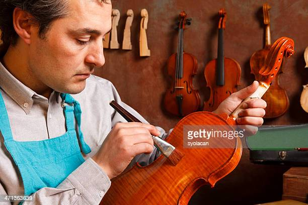 violin maker - instrument maker stock photos and pictures