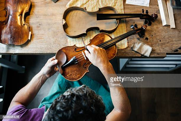 violin maker working on workbench - instrument maker stock photos and pictures