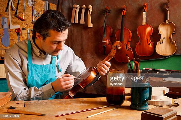 violin maker's studio - syolacan stock pictures, royalty-free photos & images