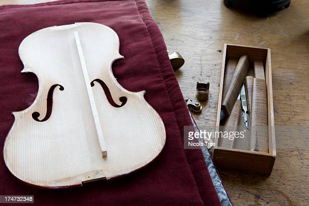 violin makers work bench with violin on it. - incomplete stock pictures, royalty-free photos & images