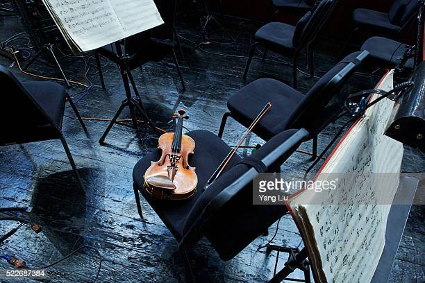 Violin on chair in orchestra pit