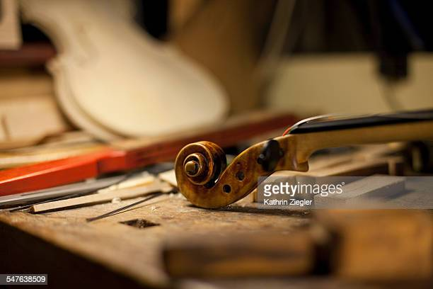 violin on worktable for restoration, close-up