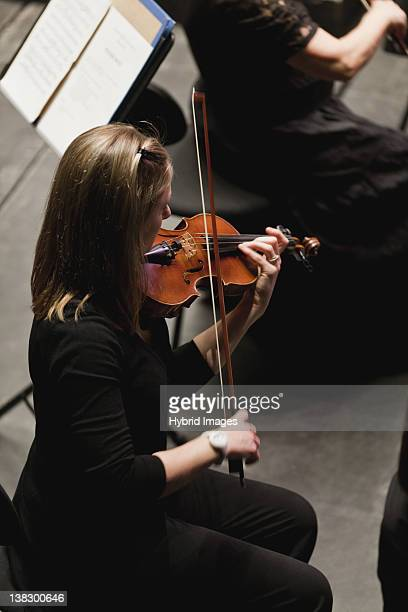 Violin player in orchestra