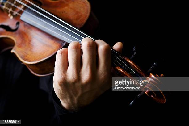 Violin player on a black background