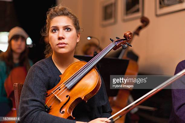Violin player sitting in practice