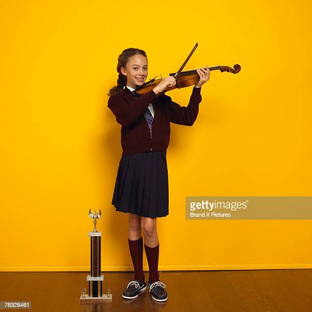 Violin player with trophy