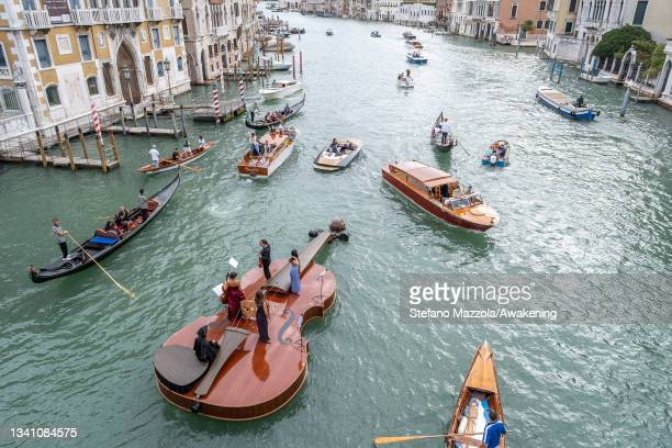 Violin shaped boat parades near the Accademia Bridge on September 18, 2021 in Venice, Italy. Violin Shaped Boat was launched on the island of...
