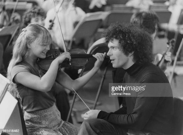 Violinist Abigail Brown of Islington and conductor Simon Rattle rehearse at Morley College on Westminster Bridge Road London for the ILEA London...