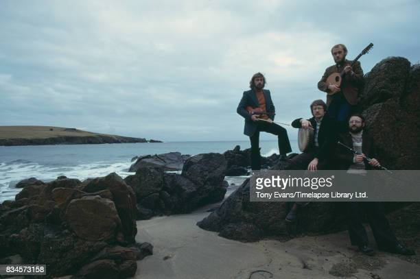 Violinist Aly Bain flutist Cathal McConnell guitarist Dick Gaughan and bodhran player Robin Morton of the ScottishCeltic band The Boys of the Lough...
