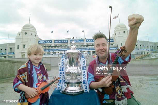 Violinist and Aston Villa fan Nigel Kennedy and son Sark pictured on Wembley Way in the lead up to the 2000 FA Cup Final played between Villa and...