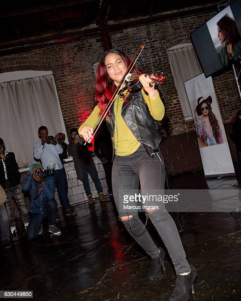 Violinist Angelina Sherie performs during the 9th Annual Celebration 4 A Cause Fashion Show at King Plow Arts Center on December 22 2016 in Atlanta...