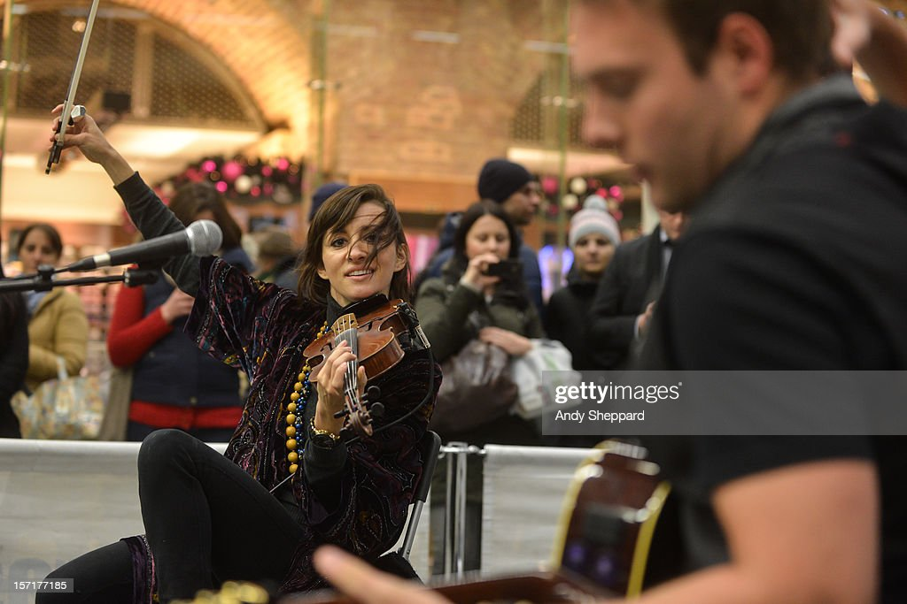 Violinist Anna Phoebe performs as part of the Station Sessions 2012 at St Pancras Station on November 29, 2012 in London, England.