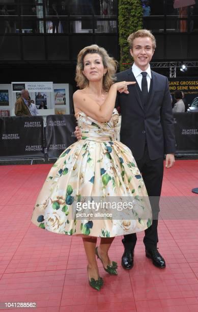 Violinist AnneSophie Mutter and her son Richard arrvie for the gala 'Arthur Cohn Der Mann mit den Träumen' at the Munich Film Festival 2014 in...
