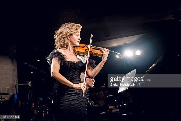 Violinist AnneSophie Mutter and Pianist Michael Abramovich perform live during a Yellow Lounge organized by recording label Deutsche Grammophon at...