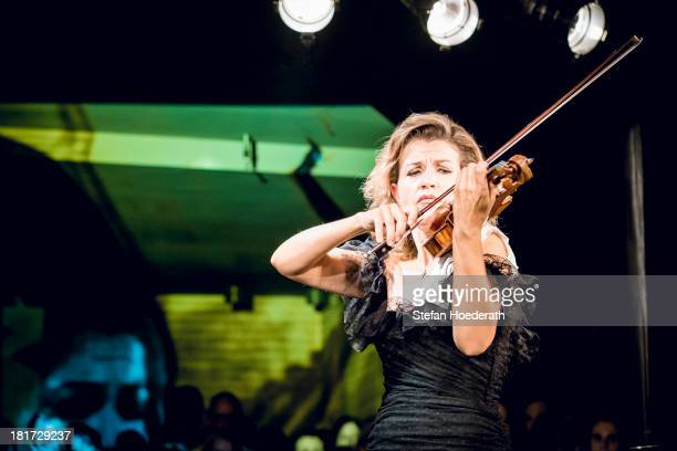 Violinist AnneSophie Mutter performs live during a Yellow Lounge organized by recording label Deutsche Grammophon at Asphalt nightclub on September...
