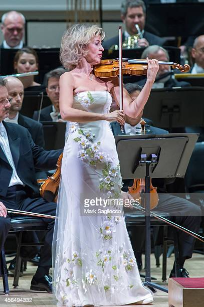 Violinist AnneSophie Mutter performs Violin Concerto No 1 with the Berliner Philharmoniker Orchestra led by Sir Simon Rattle at Carnegie Hall's...