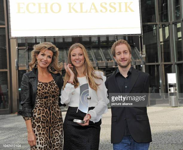 Violinist AnneSophie Mutter who received an Echo for best concert recording of the year armless hornist Felix Klieser who received an Echo for best...