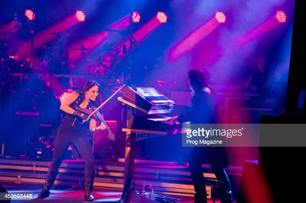Violinist Asha Mevlana and keyboardist Vitalij Kuprij of American progressive rock group TransSiberian Orchestra performing live on stage at the...