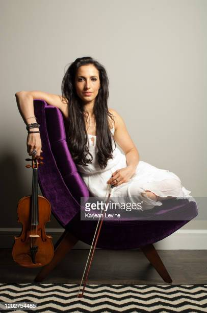 Violinist Asha Mevlana poses for a portrait with her violin on May 10 2014 in New York City New York