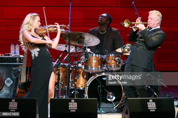Violinist Caroline Campbell and Chris Botti perform during the 2018 Montreal International Jazz Festival at Symphonic House of Montreal on July 2...