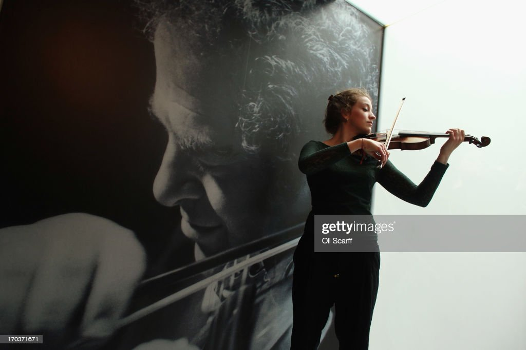 Violinist Cecelia Stinton plays a beechback Stradivarius violin on show at the exhibition 'Stradivarius' at the Ashmolean museum on June 12, 2013 in Oxford, England. The exhibition, which is the first major show of Stradivarius instruments in the UK, brings together 21 violins and cellos and runs until August 11, 2013.