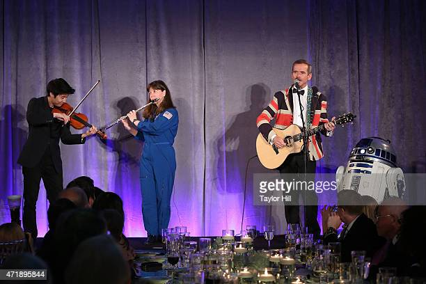 Violinist Charles Yang astronaut Cady Coleman and astronaut Chris Hadfield perform during Genius Gala 40 at Liberty Science Center on May 1 2015 in...
