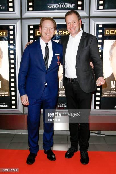 Violinist Daniel Hope and German politician Klaus Lederer attend the premiere of 'Der Klang des Lebens' at Kino in der Kulturbrauerei on October 10...