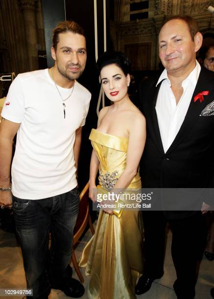 APPLY Violinist David Garrett Dita Von Teese and Group President of MAC Cosmetics John Demsey pose backstage during the 18th Life Ball at Town Hall...