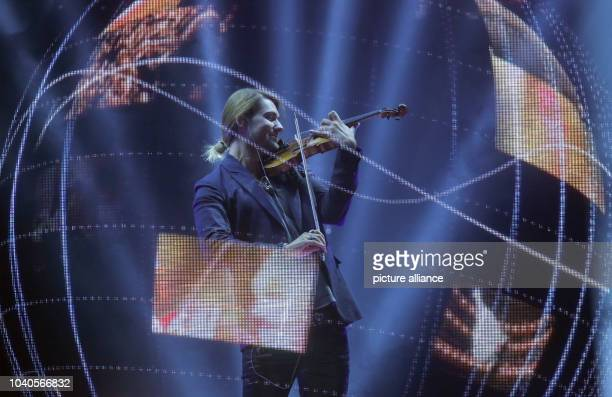 Violinist David Garrett performes at the 65th Bambi award ceremony at the Stage Theater in Berlin Germany 14 November 2013 The Burda media prize is...