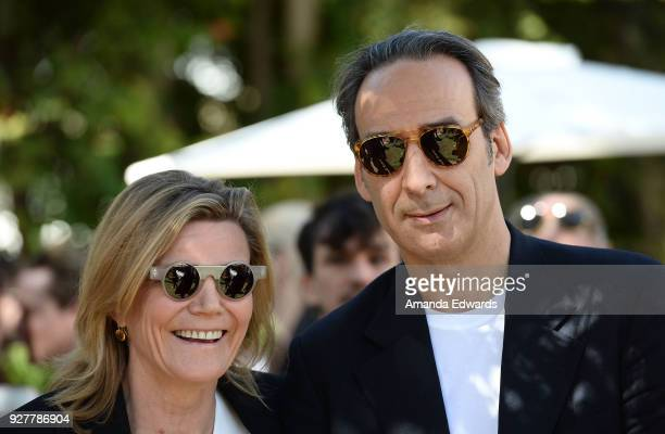 Violinist Dominique LeMonnier and composer Alexandre Desplat attend the 90th Academy Awards French Nominees Reception hosted by the Consul General of...