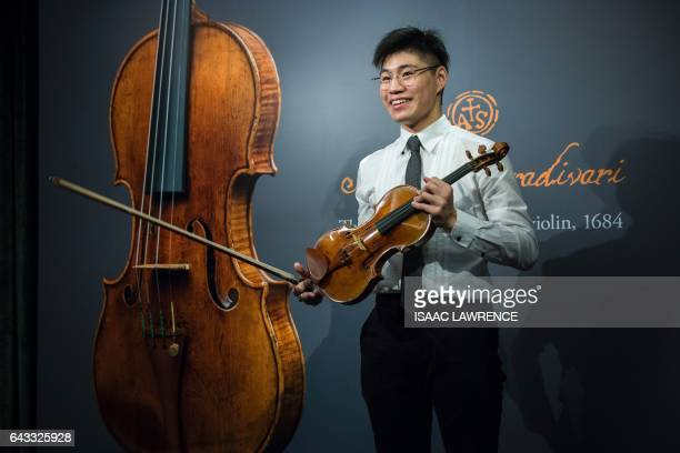 A violinist holds a rare 1684 violin by Antonio Stradivari during a media preview at Sotheby's in Hong Kong on February 21 ahead of the violin's...