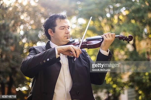 Violinist in park