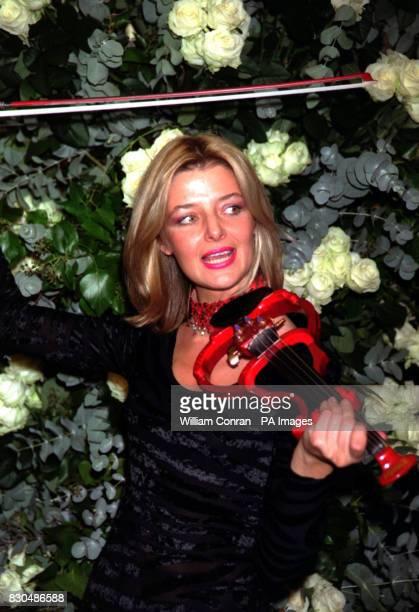 Violinist Jane Burgess at the James Bond Gala Night at the Dorchester Hotel London