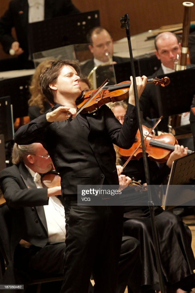 Violinist Joshua Bell with the San Diego Symphony perform on the stage in concert at Shanghai Oriental Art Center on November 5, 2013 in Shanghai, China.