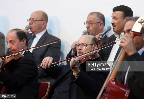 Violinist Khader Azzam performs with the Beit alRowwad ensemble during a concert at Hussein Cultural Center in Amman on March 13 2018 Beit alRowwad a...
